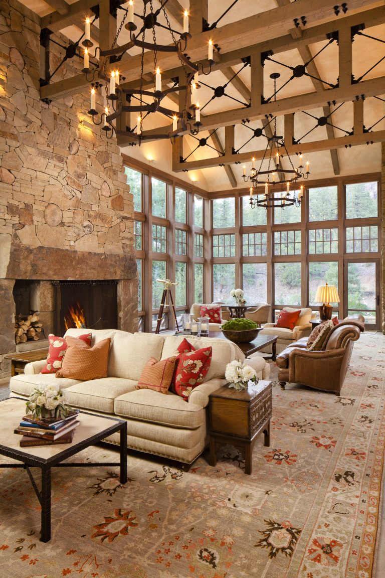 Greatroom with vaulted ceiling and windows
