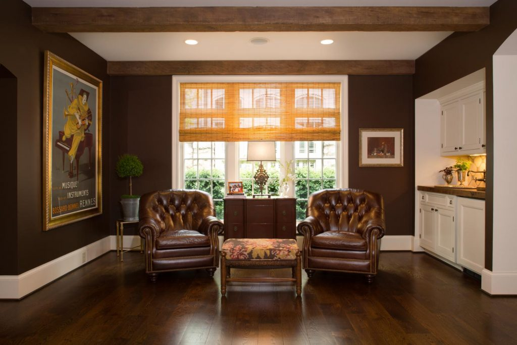 Sitting room with two chairs and a wet bar