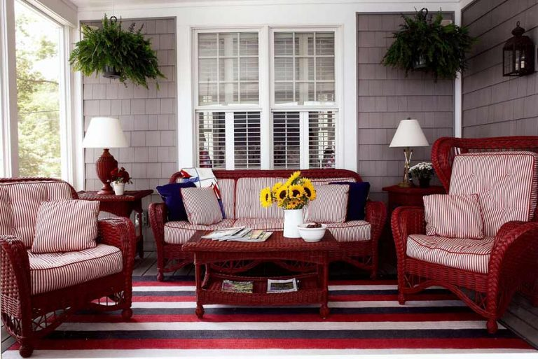 red wicker furniture on a porch