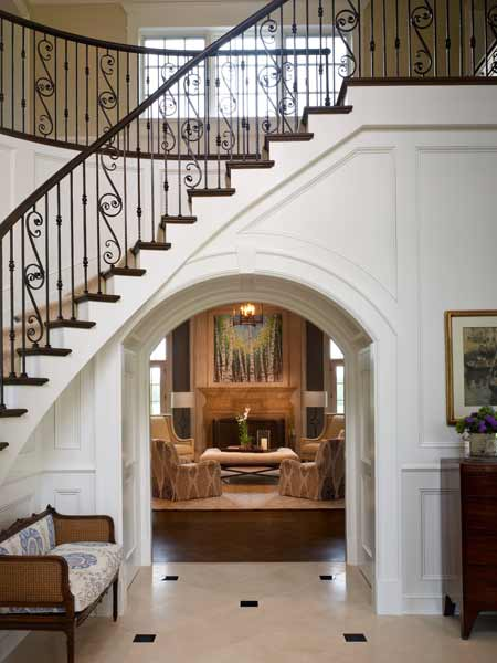 wrought iron staircase with white panel walls